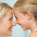 A mother and daughter rubbing their noses together playfully; Shutterstock ID 129409322; PO: The Huffington Post; Job: The Huffington Post; Client: The Huffington Post; Other: The Huffington Post